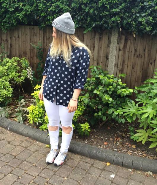 Polka dot blouse, ripped jeans